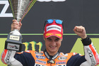 MotoGP rider Dani Pedrosa of Spain celebrates on the podium after winning the French Grand Prix, at Le Mans. Photo / AP