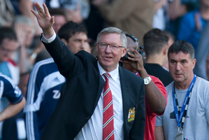 Alex Ferguson waves to supporters. Photo / AP