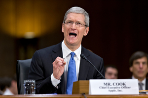 Apple CEO Tim Cook testifies on Capitol Hill in Washington. Photo / AP