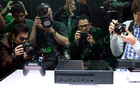 Press photographers get a shot of the Xbox One. Photo / AP