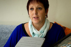 Tracey Gibb with a plaque she would like placed at the spot where her son, Joshua Bennie, died. Photo / Hawkes Bay Today