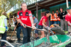 Prime Minister John Key helps out the Farmy Army volunteers, at Linwood College, following the 6.3 magnitude earthquake in March 2011. Photo / File