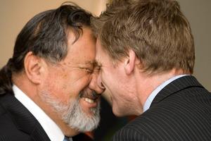Bill English receives a Hongi by Pita Sharples Minister of Maori affairs during the Whanau Ora launch at Te Puni Kokiri in Wellington. Photo / File