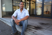 Canadian visitor Phoenix Gordon sits on a blood-stained porch at West Quay, Napier, where he was kicked on the ground as he went to the aid of another assault victim. Photo / Duncan Brown