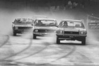 A shower of spray for the leaders in the nine-hour Benson & Hedges production car race, 1967. Photo / NZ Herald archive
