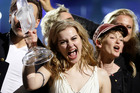 Winner of the 2013 Eurovision Song Contest Emmelie de Forest of Denmark who sang Only Teardrops, celebrates with the trophy after the final at the Malmo Arena in Malmo, Sweden Photo / AP