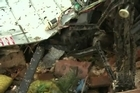 Woman finds her dog amid tornado wreckage