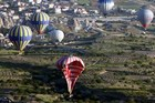 A hot-air balloon falls to the ground after colliding with another during a trip in central Turkey. Photo / AFP