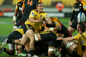 TJ Perenara of the Hurricanes passes the ball during the match against the Chiefs. Photo / Getty Images