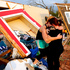 Alli Christian, left, returns Jessica Wilkinson's dog to her after finding the pet amid the wreckage of Wilkinson's home shortly after a tornado struck in Norman, Oklahoma. Photo / AP