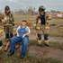 Oklahoma City firefighters check on the status of Gene Tripp as he sits in his rocking chair where his home once stood after being destroyed by a tornado that hit the area in Oklahoma City, Oklahoma. Photo / AP