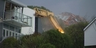 Watch: Quake-damaged cliff-top house demolished