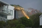 Quake-damaged cliff-top house demolished