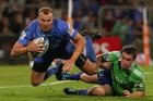Pat Dellit of the Force gets tackled by Ben Smith of the Highlanders. Photo / Getty Images