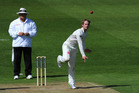 A suspect bowling action such as Kane Williamson's is often obscured by long sleeves. Photo / Getty Images