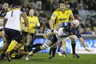 Ben Mowen of the Brumbies off loads the ball during the round 16 Super Rugby match between the Brumbies and the Hurricanes. Photo / Getty Images