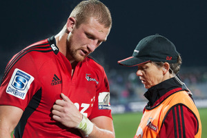 Dominic Bird is attended to by Crusaders doctor Deb Robinson. Photo / Getty Images