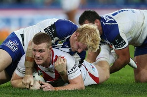 Ben Creagh of the Dragons is tackled during the round 12 NRL match between the Bulldogs and Dragons. Photo / Getty Images