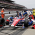 The crew of Takuma Sato, of Japan, changes his tires after Sato spun during the Indianapolis 500 auto race at the Indianapolis Motor Speedway in Indianapolis. Photo / AP