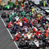 Teams, including those of Australia's Will Power (12) and Brazil's Helio Castroneves (3), pit during a yellow flag on lap 58 of the Indianapolis 500. Photo / AP