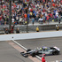 Tony Kanaan, of Brazil, celebrates as he crosses the finish line to win the Indianapolis 500 auto race at Indianapolis Motor Speedway in Indianapolis. Photo / AP