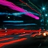 Stoplights shine like stars at top right, and traffic, seen as streaks, flows along Wilshire Boulevard in Los Angeles. The nation's most congested street. Photo / AP