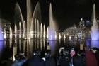 Water fountains spurt into the sky over Darling Harbor in Sydney. (AP Photo/Rick Rycroft)