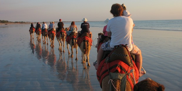 Riding into a Cable Beach sunset is an iconic Broome event. Photo Paul Rush