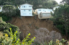 Houses on Priscilla Cres balance on the edge of a slip in Wellington's suburb of Kingston. Photo / Hagen Hopkins
