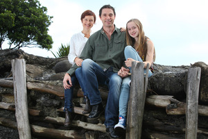 Finalist Aaron Brunet with wife Ani and daughter Ariana at Manu Bay near Raglan. Photo / Rhys Palmer