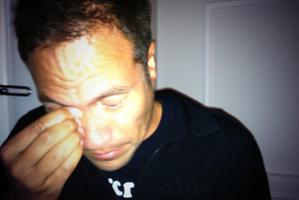 Tamati Coffey wipes his eye in an image tweeted after he was caught up in police action against protest riots in Turkey.