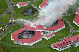 Smoke billows from two beseiged cell blocks at the Spring Hill Prison in the north Waikato. Photo / Doug Sherring