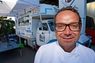 Chef Michael Van De Elzen prepares Thai food in the Food Truck. Photo / Getty Images