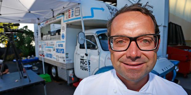 Chef Michael Van De Elzen prepares Thai food in the Food Truck. Photo / Getty Images