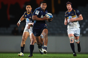 Fullback Charles Piutau provides a rare highlight for the Blues in a dismal outing against the Brumbies at Eden Park. Photo / Getty Images
