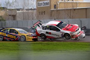 Simon McLennan gets airborne with Kayne Scott behind at Pukekohe V8 SuperTourers. Picture / Neville Bailey