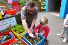 A young enthusiast learns how to grow animal food with Auckland Zoo's Project Munch. Photo / Supplied