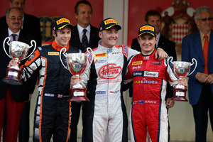 Kiwi driver Mitch Evans on the podium with winner Stefano Coletti (centre) and Adrian Quaife-Hobbs (left) after GP2 race two in Monaco. Photo / GP2 Media