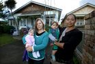 Alexandra Inkersell (left, with baby Emily) and Claude Galpin (with son Benjamin) oppose apartments in their character street. Photo / Brett Phibbs