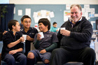 Milo Kids Hamiora Samuels (9), Sonny Pawa (11) and Heperone Kiao (11) enjoy a break with Steve Farrelly before starting the morning at Randwick Park School in Manurewa. Photo / Greg Bowker