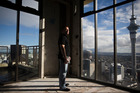 Charles Shrimpton looks out from a 37th-floor apartment in the Metropolis building. Photo / Greg Bowker