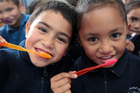 Anthony Harrison and Latoya Uerata were all smiles this week at Kelvin Rd School as the nationwide roll-out of free dental kits began. Photo / Doug Sherring