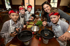 Vanessa Baxter with King's School pupils (left to right) Andrew Cao, Miles Ball, Lars Featherstone and Ted Yates, who can't wait to get cooking. Photo / Brett Phibbs