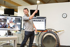 Co-founder Shaun Ryan strikes the gong as SLI debuts on the main board yesterday. Photo / Supplied