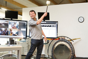 SLI Systems co-founder Shaun Ryan strikes a gong as SLI debuts on the NZX.