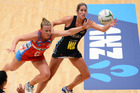 Jessica Tuki goes for the ball under pressure from NSW swifts player Kimberlee Green (L). Photo / Photosport