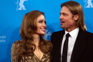 Angelina Jolie, pictured with husband Brad Pitt, says other women with a history of breast cancer in their families should seek medical advice. Photo / AP