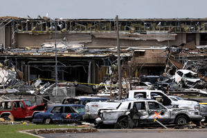 Destroyed vehicles and other tornado debris pile up in front of the Moore Medical Centre.  Photo / AP