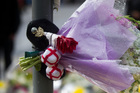 Tributes to slain soldier Lee Rigby outside the Woolwich Royal Artillery Barracks in London. Photo / AP