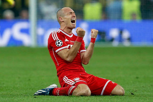 Bayern's Arjen Robben celebrates victory after the final whistle in the match against Borussia Dortmund. Photo / AP